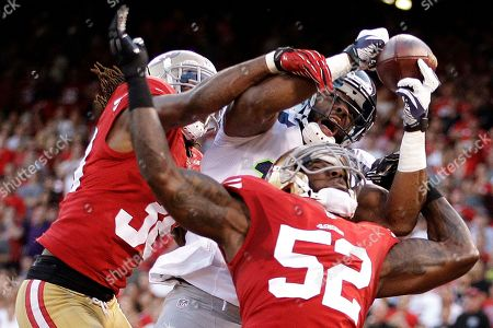 Braylon Edwards, Patrick Willis, Dashon Goldson. San Francisco 49ers linebacker Patrick Willis (52) and safety Dashon Goldson break up a pass intended for Seattle Seahawks wide receiver Braylon Edwards during the second quarter of an NFL football game in San Francisco