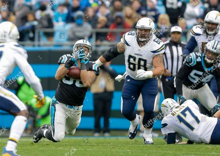 Wes Horton, Matt Slauson. Carolina Panthers' Wes Horton (96) recovers a fumble as San Diego Chargers' Matt Slauson (68) moves in to make the tackle during the first half of an NFL football game in Charlotte, N.C., . The Panthers won 28-16