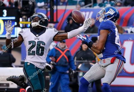 Stock Picture of New York Giants wide receiver Rueben Randle (82) makes a catch against Philadelphia Eagles strong safety Walter Thurmond (26) for a touchdown during the third quarter of an NFL football game, in East Rutherford, N.J