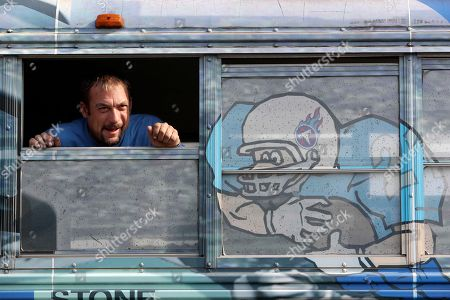 Stock Picture of Tennessee Titans fan Justin Miles, looks through a bus window in the parking lot of Nissan Stadium before an NFL football game between the Titans and the Green Bay Packers, in Nashville, Tenn
