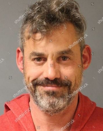 """This, booking photo provided by the Saratoga Springs Police Department shows Nicholas Brendon, who was arrested Wednesday, Sept. 30, after a fight with his girlfriend. Police say the actor known for his role in the television series """"Buffy the Vampire Slayer,"""" is facing charges of felony third-degree robbery, misdemeanor obstruction of breathing and two criminal mischief counts"""