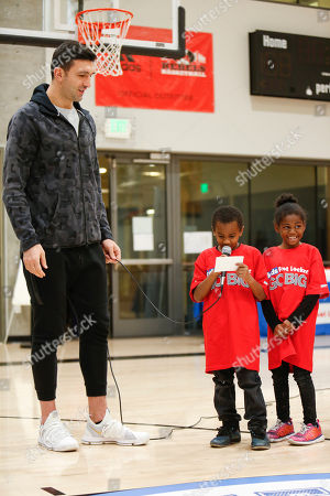 Golden State Warriors' center Zaza Pachulia presents a $25,000 check from Kids Foot Locker Foundation to Boys & Girls Clubs of San Francisco for completing the Kids Foot Locker Fitness Challenge on in San Francisco