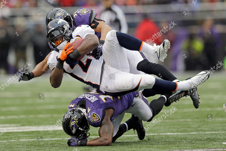 Knowshon Moreno, Brendon Ayanbadejo, James Ihedigbo. Denver Broncos running back Knowshon Moreno is stopped by Baltimore Ravens inside linebacker Brendon Ayanbadejo, top, and defensive back James Ihedigbo, bottom during the first half of an NFL football game in Baltimore