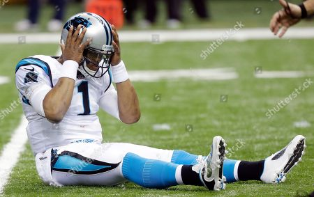 Carolina Panthers quarterback Cam Newton reacts after throwing an interception that was returned for a touchdown by New Orleans Saints' Jonathan Vilma during the first half of an NFL football game, in New Orleans