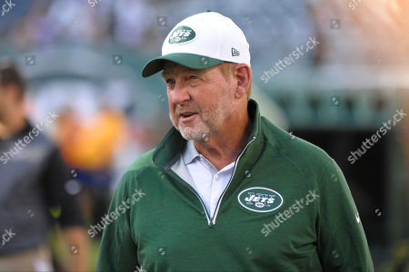 """New York Jets offensive coordinator Chan Gailey watches his team warm up for an NFL preseason football game against the Atlanta Falcons in in New York. Quarterback Ryan Fitzpatrick is having a career year, Brandon Marshall is putting up what could end up being the most dominant receiving numbers in single-season franchise history and the Jets (8-5) are ranked No. 9 in overall offense. They haven't finished in the top 10 since 1998. And, a lot of the credit goes to the 63-year-old offensive coordinator who decided last winter to return to the game. """"I wanted to win a championship,"""" he said"""