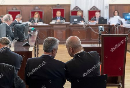 Former Andalusia's regional government presidents Manuel Chaves (R) and Jose Antonio Grinan (L) attend a trial at the Provincial Court in Seville, Spain, 13 December 2017. Grinan is to testify as a suspect in the case of a regional employment regulation scandal so called ERE case. The court investigates the alleged plot for the illegal concession of public funds by means of fake labour force adjustment plans.