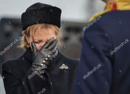 Princess Margaret of Hohenzollern, daughter of former Romanian King Michael I, cries next to his coffin, at Bucharest's Henri Coanda airport, outside Bucharest, Romania, . Former King Michael, who ruled Romania during WWII, has died on Dec. 5, aged 96, in Switzerland and will be buried this weekend