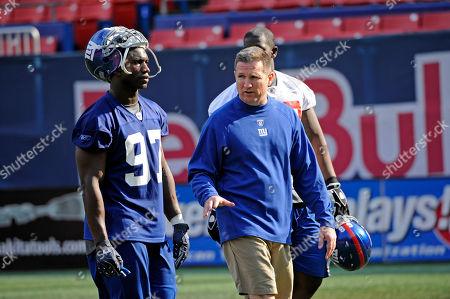 Bill Sheridan, Clint Sintim. New York Giants defensive coordinator Bill Sheridan, right, talks with linebacker Clint Sintim at rookie football mincamp in East Rutherford, N.J