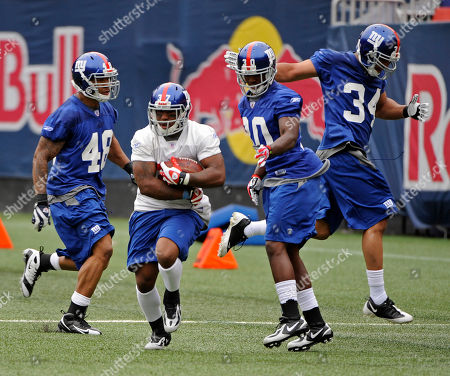 New York Giants running back Andre Hall (37) runs with the ball at rookie football mincamp in East Rutherford, N.J