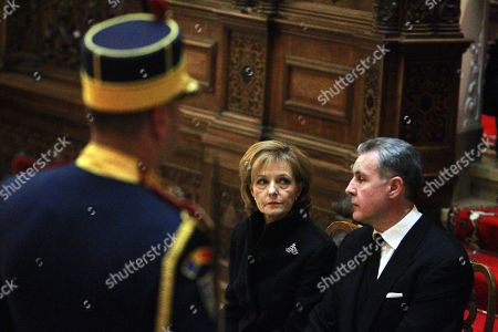 Princess Margareta of Romania (C), Custodian of the Crown of Romania and former Princess of Hohenzollern, stands next to her husband Prince Radu Duda (R) next the coffin of her father late King Michael I of Romania during a ceremony held at Peles Castle, 130 km north of Bucharest, Romania 13 December 2017. The royal house of Romania announced on 05 December 2017 that former King Michael I of Romania has died at his residence in Switzerland at the age of 96. Romanian government has declared four days of national mourning. The body of King Michael I of Romania will arrive on 13 December. He will be buried at the Royal grave located in the city of Curtea de Arges, 160 km north of Bucharest.