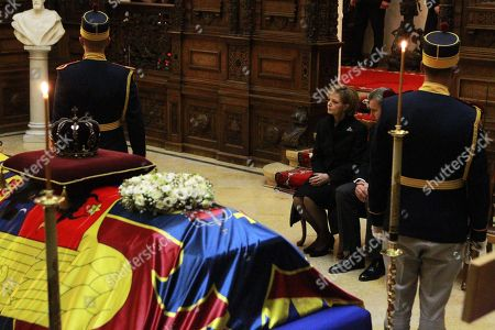 Princess Margareta of Romania (C), Custodian of the Crown of Romania and former Princess of Hohenzollern with her husband Prince Radu Duda (2-R) next the coffin of her father late King Michael I of Romania during a ceremony held at Peles Castle, 130 km north of Bucharest, Romania 13 December 2017. The royal house of Romania announced on 05 December 2017 that former King Michael I of Romania has died at his residence in Switzerland at the age of 96. Romanian government has declared four days of national mourning. The body of King Michael I of Romania will arrive on 13 December. He will be buried at the Royal grave located in the city of Curtea de Arges, 160 km north of Bucharest.