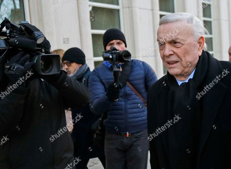Jose Maria Marin, of Brazil, right, is followed by reporters as he arrives to federal court in the Brooklyn borough of New York, . Closing arguments are set to take place in the New York trial of three former South American soccer officials charged in the bribery scandal engulfing the sport's governing body