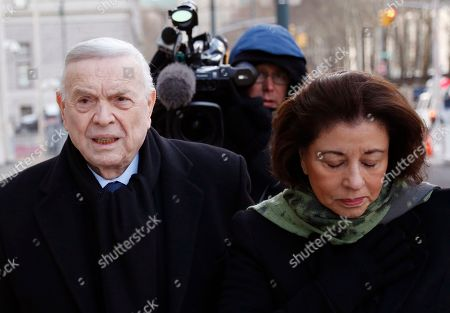 Jose Maria Marin, of Brazil, left, arrives to federal court in the Brooklyn borough of New York, . Closing arguments are set to take place in the New York trial of three former South American soccer officials charged in the bribery scandal engulfing the sport's governing body