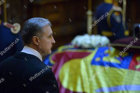 Prince Radu of Romania mourns the former Romanian King Michael I next to his coffin at Castle Peles