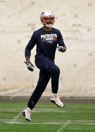 New England Patriots wide receiver Kenny Britt warms up during an NFL football practice, in Foxborough, Mass