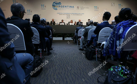 Stock Photo of President of the World Trade Organization Ministerial Conference Susana Malcorra, center right, talks during the closing ceremony of the WTO Ministerial Conference in Buenos Aires, Argentina