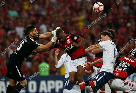 Brazil's Flamengo Juan, center, is blocked by Argentina's Independiente's Damian Albil, left, and Fernando Amorebieta, right, during the Copa Sudamericana final championship soccer match at Maracana stadium in Rio de Janeiro, Brazil, Wednesday, Dec.13, 2017. At right is Flamengo's Rever