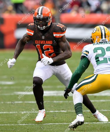 Stock Picture of Josh Gordon, Damarious Randall. Cleveland Browns wide receiver Josh Gordon (12) runs a route against Green Bay Packers cornerback Damarious Randall (23) during an NFL football game, in Cleveland. Green Bay won 27-21 in overtime