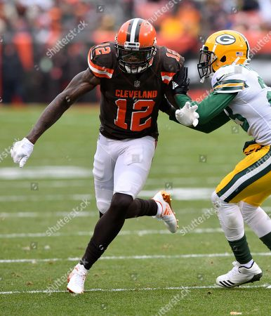 Josh Gordon, Damarious Randall. Cleveland Browns wide receiver Josh Gordon (12) runs a route against Green Bay Packers cornerback Damarious Randall (23) during an NFL football game, in Cleveland. Green Bay won 27-21 in overtime
