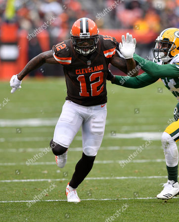 Stock Image of Josh Gordon, Damarious Randall. Cleveland Browns wide receiver Josh Gordon (12) runs a route against Green Bay Packers cornerback Damarious Randall (23) during an NFL football game, in Cleveland. Green Bay won 27-21 in overtime