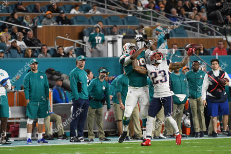 Patrick Chung #23 of New England breaks up a pass intended for Julius Thomas #89 of Miami during the NFL football game between the Miami Dolphins and New England Patriots at Hard Rock Stadium in Miami Gardens FL. The Dolphins defeated the Patriots 27-20