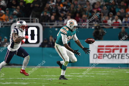 Julius Thomas #89 of Miami is chased and tackled by Patrick Chung #23 of New England after recovering his own fumble during the NFL football game between the Miami Dolphins and New England Patriots at Hard Rock Stadium in Miami Gardens FL. The Dolphins defeated the Patriots 27-20