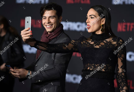 "Manolo Gonzalez-Ripoll Vergara, Daniela Botero. Manolo Gonzalez-Ripoll Vergara, left, and Daniela Botero take a selfie as they arrive at the U.S. premiere of ""Bright"" at the Regency Village Theatre, in Los Angeles"