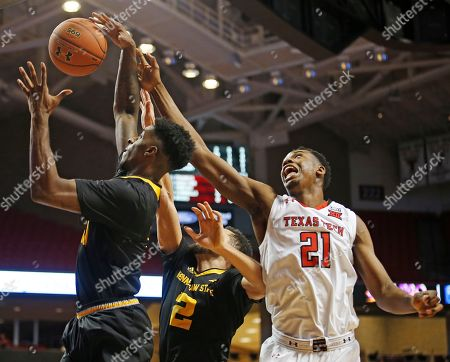 Malik Ondigo, Kyle Clarke, Jordan Jones. Texas Tech's Malik Ondigo (21) tries to knock the rebound away from Kennesaw State's Kyle Clarke (11) and Jordan Jones (2) during the second half of an NCAA college basketball game, in Lubbock, Texas