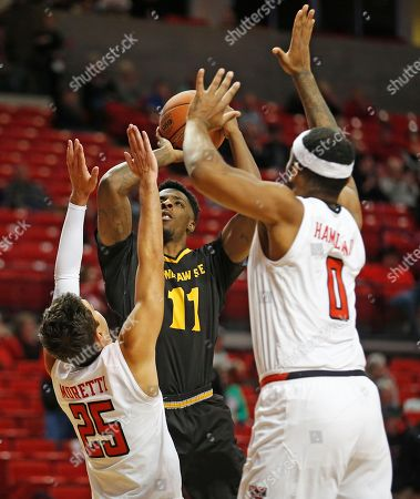 Kyle Clarke, Davide Moretti, Tommy Hamilton. Kennesaw State's Kyle Clarke (11) shoots the ball over Texas Tech's Davide Moretti (25) and Tommy Hamilton (0) during the second half of an NCAA college basketball game, in Lubbock, Texas