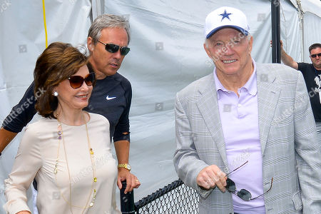 """Wife Eugenia, Jerry Jones, Rich Dalrymple. Left to right) Wife Eugenia Jones, Dallas Cowboys owner Jerry Jones and team spokesman Rich Dalrymple arrive at the """"state of the team"""" news conference during the start of Dallas Cowboys' NFL training camp, in Oxnard, Calif"""