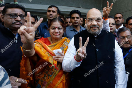 Amit Shah, Sonal Shah. India's ruling Bharatiya Janata Party(BJP) president Amit Shah and his wife Sonal Shah display victory sign after casting their votes for the second phase of Gujarat state assembly elections in Ahmadabad, India, . The result will be declared on Dec. 18