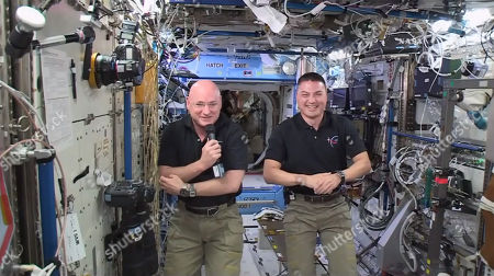 """In this image made from video provided by NASA, astronauts Scott Kelly, left, and Kjell Lindgren, aboard the International Space Station, speak to actors from the movie """"The Martian."""" On Tuesday, Kelly and Russian cosmonaut Mikhail Kornienko clocked in for their 171st day aboard the International Space Station since arriving on March 27. The two are scheduled to spend 342 days in space"""