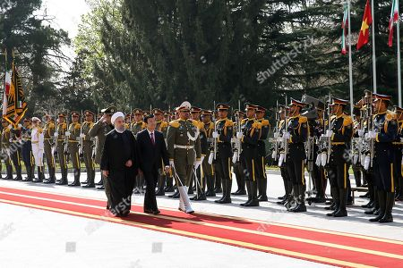 Hassan Rouhani, Truong Tan Sang. Vietnam's President Truong Tan Sang, center, reviews honor guards as he is welcomed by his Iranian counterpart Hassan Rouhani, left, in an official arrival ceremony at the Saadabad Palace in Tehran, Iran