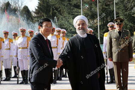 Hassan Rouhani, Truong Tan Sang. In this photo released by official website of the office of the Iranian Presidency, President Hassan Rouhani, right, shakes hands with Vietnam's President Truong Tan Sang, prior to their meeting in Tehran, Iran