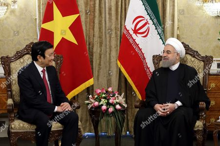 Stock Photo of Hassan Rouhani, Truong Tan Sang. In this photo released by official website of the office of the Iranian Presidency, President Hassan Rouhani, right, meets with Vietnam's President Truong Tan Sang at the Saadabad Palace in Tehran, Iran