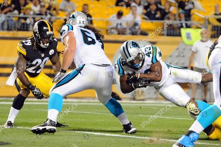 Shamarko Thomas, Fozzy Whittaker. Carolina Panthers running back Fozzy Whittaker (43) dives for a touchdown as center Brian Folkerts (64) blocks Pittsburgh Steelers strong safety Shamarko Thomas (29) in the third quarter of the NFL preseason football game on in Pittsburgh