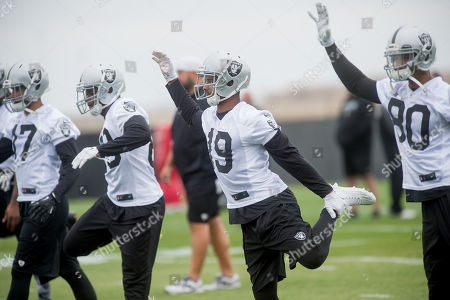 Josh Harper stretches during an Oakland Raiders workout, in Alameda, Calif