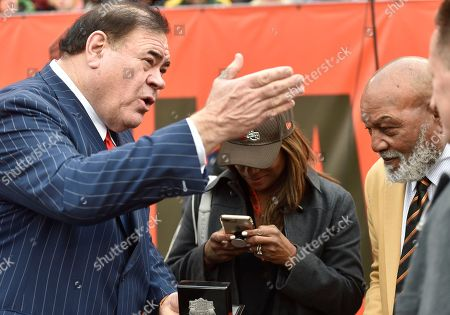 Jim Brown, Monique Brown, David Baker. Pro Football Hall of Fame president David Baker, left, talks with Jim Brown, right, and his wife, Monique Brown, during halftime of an NFL football game between the Cleveland Browns and the Green Bay Packers, in Cleveland. The Packers won 27-21 in overtime