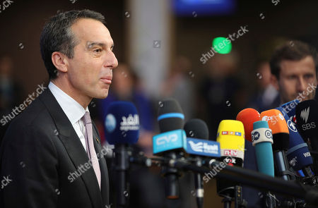 Austrian Chancellor Christian Kern speaks with journalists as he arrives for an EU summit at the Europa building in Brussels on . European Union leaders are gathering in Brussels and are set to move Brexit talks into a new phase as pressure mounts on Prime Minister Theresa May over her plans to take Britain out of the 28-nation bloc