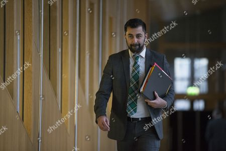 Scottish Parliament First Minister's Questions - Humza Yousaf, Minister for Transport and the Islands, makes his way to the Debating Chamber