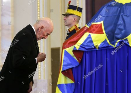 Simeon II of Bulgaria (L) touches the coffin of late King Michael I of Romania, who is lying in state for public mourning in the Hall of the Throne of former Royal Palace, in Bucharest, Romania, 14 December 2017. The royal house of Romania announced on 05 December 2017 that former King Michael I of Romania died at his residence in Switzerland at the age of 96. Romanian government declared four days of national mourning. He will be buried at the Royal grave located in the city of Curtea de Arges, 160 km north of Bucharest.