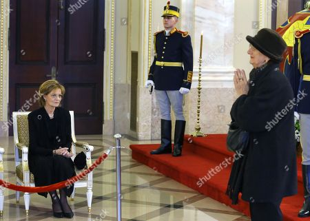 Stock Picture of Princess Margareta of Romania (L), Custodian of the Crown of Romania and former Princess of Hohenzollern is saluted by an elderly woman (R), who just paid respect at the coffin of late King Michael I of Romania, who is lying in state for public mourning in the Hall of the Throne of former Royal Palace, in Bucharest, Romania 14 December 2017. The royal house of Romania announced on 05 December 2017 that former King Michael I of Romania died at his residence in Switzerland at the age of 96. Romanian government declared four days of national mourning. He will be buried at the Royal grave located in the city of Curtea de Arges, 160 km north of Bucharest.