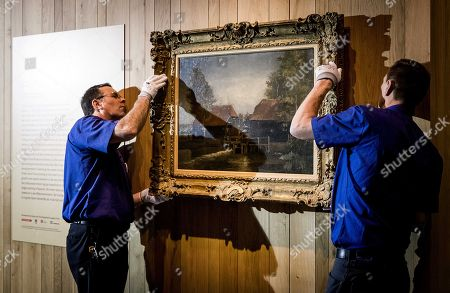 Museum workers fix the Vincent van Gogh's painting 'Watermill at Kollen' at The Noordbrabants Museum in Den Bosch, in The Netherlands, 14 December 2017. It was purchased for almost 3 million euros (hammer price 2,6 million dollars).
