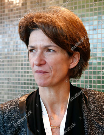 CEO of French gas and power group Engie Isabelle Kocher pose for a photo during the One Planet Summit, in Boulogne-Billancourt near Paris, France, . More than 50 world leaders are gathering in Paris for a summit that President Emmanuel Macron hopes gives new momentum to the fight against global warming despite U.S. President Donald Trump's rejection of the Paris climate accord. (AP Photo/Michel Euler