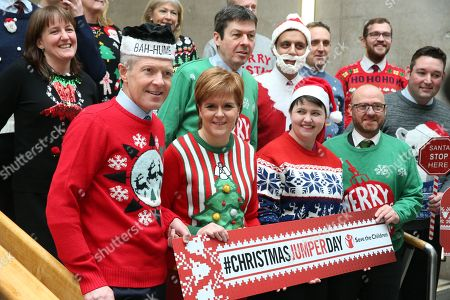 Scottish political leaders wear Christmas Jumpers for Save the Children - Maree Todd, Minister for Childcare and Early Years, Willie Rennie, Leader of the Scottish Liberal Democrats, Nicola Sturgeon, First Minister of Scotland and Leader of the Scottish National Party (SNP), Ken Macintosh, The Presiding Office of The Scottish Parliament,  Anas Sarwar, Scottish Labour, Ruth Davidson, Leader of the Scottish Conservative and Unionist Party, and Patrick Harvie, Co-convener of the Scottish Greens
