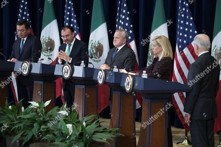 Stock Image of Mexican Foreign Secretary Luis Videgaray (2-L), with Mexican Secretary of Interior Miguel Angel Osorio Chong (L), US Deputy Secretary of State John Sullivan (C), US Secretary of Homeland Security Kirstjen Nielsen (2-R) and US Attorney General Jeff Sessions (R), responds to a question from the news media during a joint press conference on the Strategic Dialogue on Disrupting Transnational Criminal Organizations at the US State Department in Washington DC, USA, 14 December 2017.