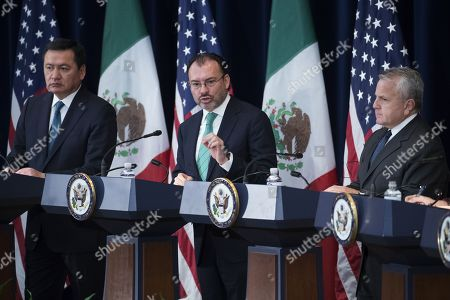 Stock Picture of Mexican Foreign Secretary Luis Videgaray (C), with Mexican Secretary of Interior Miguel Angel Osorio Chong (L) and US Deputy Secretary of State John Sullivan (R), responds to a question from the news media during a joint press conference on the Strategic Dialogue on Disrupting Transnational Criminal Organizations at the US State Department in Washington DC, USA,14 December 2017.