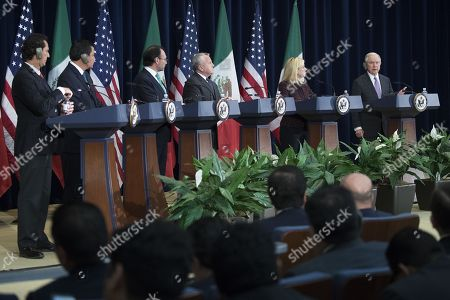 Stock Photo of US Attorney General Jeff Sessions (R), with acting Mexican Attorney General Alberto Elias Beltran (L), Mexican Secretary of Interior Miguel Angel Osorio Chong (2-L), Mexican Foreign Secretary Luis Videgaray (3-L), US Deputy Secretary of State John Sullivan (3-R) and US Secretary of Homeland Security Kirstjen Nielsen (2-R), responds to a question from the news media during a joint press conference on the Strategic Dialogue on Disrupting Transnational Criminal Organizations at the US State Department in Washington DC, USA,14 December 2017.