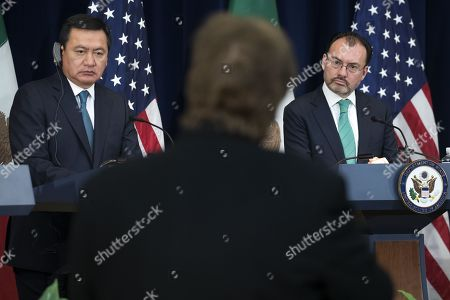 Mexican Secretary of Interior Miguel Angel Osorio Chong (L) and  Mexican Foreign Secretary Luis Videgaray (R) listen to a question from the news media during a joint press conference on the Strategic Dialogue on Disrupting Transnational Criminal Organizations at the US State Department in Washington DC, USA, 14 December 2017.