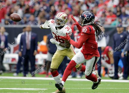 Houston Texans wide receiver DeAndre Hopkins (10) makes a catch in front of San Francisco 49ers cornerback Dontae Johnson (36) during the first half of an NFL football game against the San Francisco 49ers, in Houston
